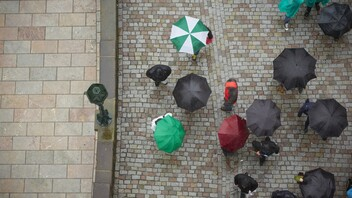 Birds-eye view, umbrellas in street, rain.  Photo used first in the Sustainability Report 2017