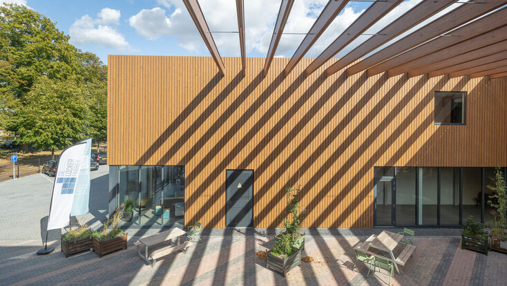 EromesMarko office building and factory in Wijchen, Netherlands cladded with Rockpanel Woods (custom design) facade cladding.